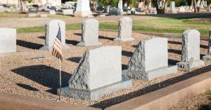 grave stones with American flag