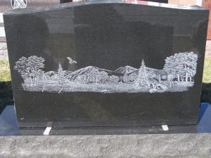blank headstone with mountain etching