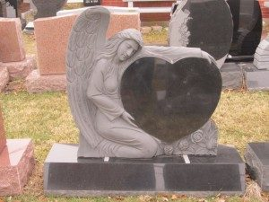 blank heart grave stone with angel statue